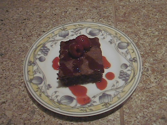 Double Chocolate Brownies with Raspberry Reduction Sauce